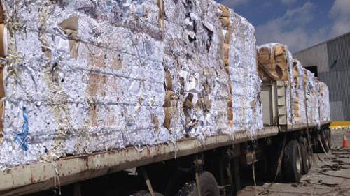 Truck carrying large amount of recyclable materials to a factory